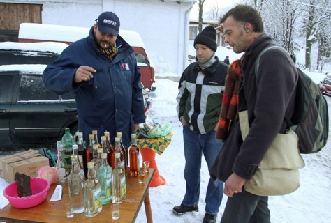SERBIA: A tourist talks with a Serbian selling homemade brandy at the foot of Mount Rtanj. Visitors have flocked to the mountain in south-eastern Serbia because its pyramidal shape apparently gives Rtanj 'mystical powers', allowing it to survive the apocalypse