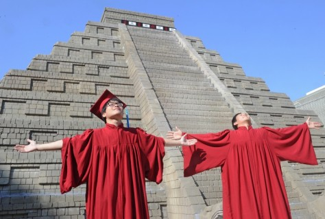 TAIWAN: University students celebrate their graduation in front of a replica of a Mayan pyramid. The National Museum of Natural Science erected the pyramid outside the museum, and placed a 'digital doomsday countdown clock' on top, in an attempt to reassure the public that 21 December would not be the end of the world