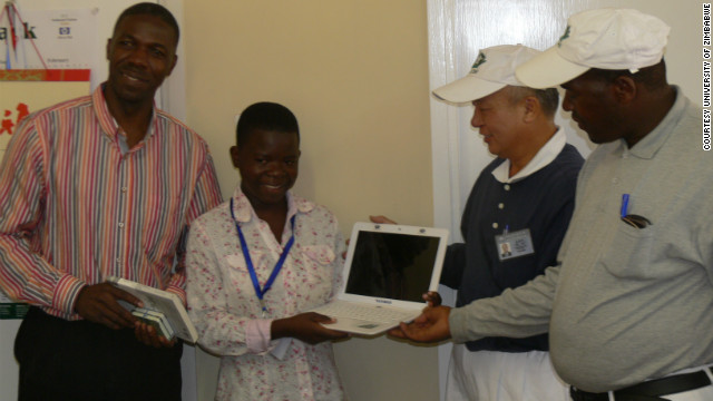 Maud, standing next to Munyaradzi Madambi, the dean of students at the University of Zimbabwe, received last week a donation of a laptop by the TZU CHI Foundation