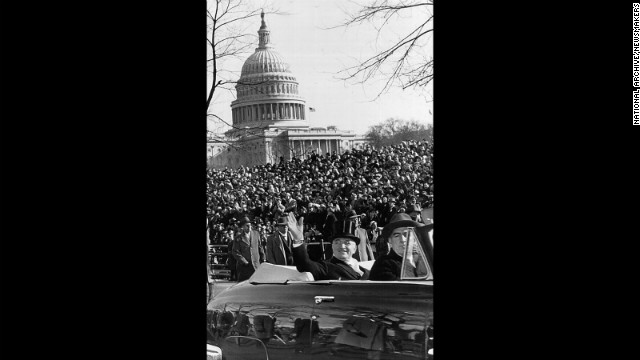 President Harry S. Truman waves to the crowd from a car during a parade after his inauguration speech on January 20, 1949