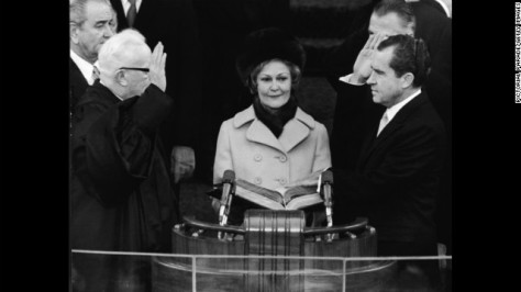 Richard Nixon takes the oath of office as he is sworn in as the 37th president of the United States on January 20, 1969