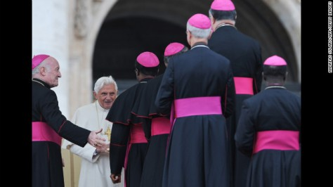 Benedict talks with bishops in Saint Peter's Square at the Vatican after his weekly general address in November 2009.