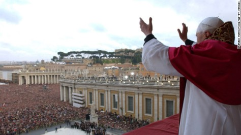 Newly elected as pope, Benedict XVI gestures to the crowd in St. Peter's Square in Vatican City on April 19, 2005.