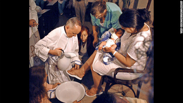 Bergoglio is shown washing the feet of a woman on Holy Thursday at the Sarda maternity hospital in Buenos Aires in 2005